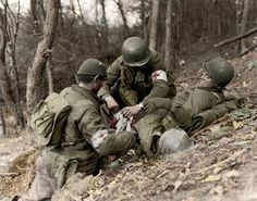 U.S. medics treat a wounded soldier during the Battle of the Bulge.  Winter, 1944