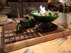 Printers tray as base for table centerpiece. Seen at Mamas Happy in Independence, MN