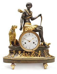 Pendule symbolysant l'Afrique d'après un modèle de Deverberie; bronze patiné doré, cadran marqué Geulin à Paris. Début XIXe  45 x 36cm.