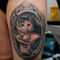Cat tattoo framed