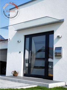 The Cologne model is a self-supporting glass-stainless steel canopy with minimalist .The Cologne model is a cantilever glass-stainless steel canopy with a minimalist look. A particularly load-bearing laminated safety glass pane made of special glass Modern Entrance Door, Modern Front Door, House Entrance, Entrance Doors, Garage Doors, Front Door Canopy, Porch Canopy, Bed Curtains, Door Design