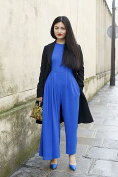 Electric blue Dior jumpsuit a and lady Dior bag going to the couture shows.