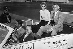 """Barbara Stanwyck and Clark Gable brought major star power to the 1950 Indy 500 while promoting """"To Please a Lady."""" Note Wilbur Shaw driving and Tony Hulman riding shotgun."""