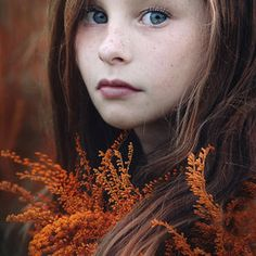 portrait little girl with freckles fall shot