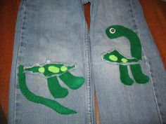 Dinosaur knee patches made of felt and hand stitched for jeans.