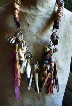 Dr Mojo Gris gris Necklace by vLaDtHeBaT on Etsy  |  Materials: coral, amber, turquoise, bronze, brass, copper, silver, bone, shell, teeth, antler, clay, wood