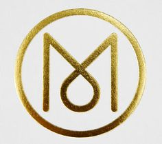 Monocle logo gold foiled
