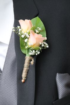 Boutonniere with peach/coral garden roses, wrapped with twine to match the burlap & canning jar weddings. Created by Judith Marie at Fox Bros Floral, Hartland, WI