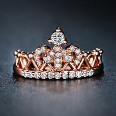 This beautiful rose gold crown ring is individually handcrafted with sparkling cubic zirconia pave setting. We use top grade AAA swiss-made CZ, the ring is eco-friendly and does not contain lead, nickel or cadmium. It features High Quality 18K Rose Gold plated on brass for tarnish resistance and a long lasting mirror finish.
