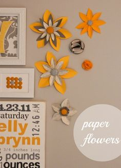 DIY paper flowers for wall decoration. How pretty!!