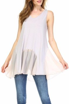 Add gorgeous length any top in your wardrobe with this chiffon Flowy Top Extender. It has one layer of wrinkle-free chiffon which is scalloped along with the super soft stretchy material from the upper slip. Wear it solo or add any top/vest/jacket - the possibilities are endless. It has a T-back with good coverage. Flowy Top Extender by Melody. Clothing - Tops - Tunics Indiana