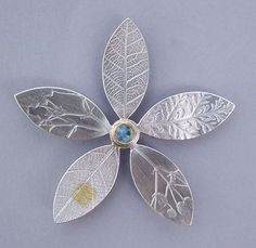 moonstone flower brooch   Contemporary Brooches by contemporary jewellery designer Naomi James