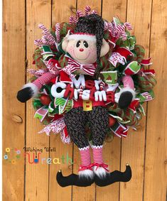 This adorable Christmas elf wreath is full of fun surprises the handmade Elf attachment sits on red and green Deco mesh. the cute elf hands and legs attachment is made up of fun printed patterns perfect for one of Santa's elves. The fabric is a black with little candy canes dancing around print mix that with fun red and white stripes with Black and white furry fabrics and you've got a perfect combination for an adorable Christmas Wreath!