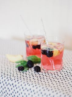 Blackberry Lemon Gin & Tonic: http://www.stylemepretty.com/2015/08/18/signature-wedding-cocktails-in-10-shades-of-pink/