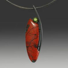 """Wolfgang Vaatz: , Pendant in cuprite and chrysocolla from Sonora Mexicvo, 6mm peridot, and oxidized sterling silver. Pendant only. Neckwire sold separately. 2.56 x 0.73 x 0.28""""."""