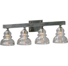 View the Troy Lighting B3954 Menlo Park 4 Light Bathroom Vanity Light with Glass Insulator Shades at LightingDirect.com.