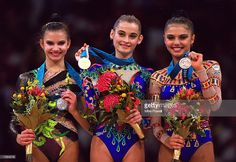 Yulia Barsakova of Russia (centre) wins Gold, Yulia Raskina of Belarus (left) wins Silver and Alina Kabaeva of Russia (right) wins Bronze in the Womens Rhythmic Gymnastics at Pavilion 3 on day 16 of the Sydney 2000 Olympic Games in Sydney, Australia. \ Mandatory Credit: Mike Powell /Allsport