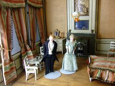 antique dollhouse and dolls.
