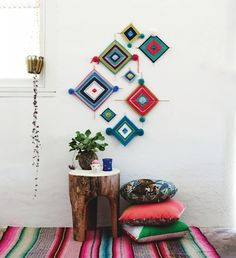 I like the idea of hanging these on a small side wall, the kids could make these God's Eyes