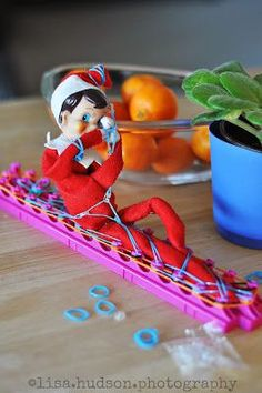 Elf on the Shelf is in a bunch of trouble.. The hazards of rubber band bracelet making! #charlottepediatricclinic