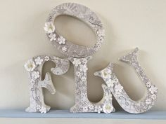 A personal favourite from my Etsy shop https://www.etsy.com/uk/listing/267048040/decorated-wedding-letters-vintage