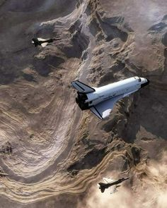 Two F-16 Falcons escorting Discovery Space Shuttle