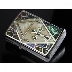 NEW Zippo Lighter Armor Shell Inrey Cross Best deal F/S.Specifications: Back side silver plain, Diano silver mirror finish, White shell & Mexican shell inlaid (transparent epoxy coated finish).  Accessories: · ZIPPO only box · ZIPPO company permanent guarantee