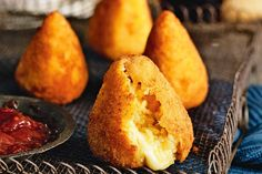 Golden savoury street snacks stuffed full of flavour and oozing with melted cheese... that's the way they roll in Sicily, the home of arancini.