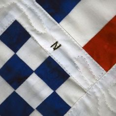 Add a unique, nautical touch to your home with a nautical flags quilted banner - spelling the custom location of your choice. Carrying on a craft her great-grandmother practiced in the crafter Kathy Baltz hand-stitches each banner in New England Nautical Flags, Nautical Wall Decor, Flag Quilt, Hand Stitching, Banner, Nantucket, Spelling, Touch, Holidays