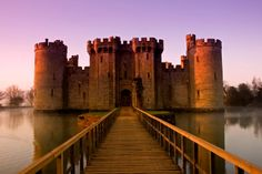 Europe's most famous castles and palaces - Bodiam Castle, near Robertsbridge, England, originally had many water features for defense but only the imposing moat survives to this day. by Oliver Taylor Bodiam Castle, Arundel Castle, Beautiful Castles, Beautiful Buildings, Beautiful Architecture, Beautiful Scenery, Beautiful Homes, Castillo Bodiam, Rochester Castle