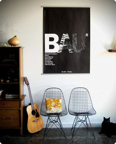 poster by Armin Hoffmin, chairs by Eames, Aspen bowl by Robert Gray