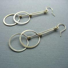 Two Circles Long Dangling Sterling Silver Earrings. $32.00, via Etsy.