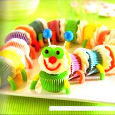 Cupcakes stuck together with icing, gummy worms legs, and a candy face! Soo cuutee!