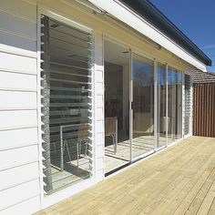 Aluminium Sliding Doors, triple-stack alu one way slide, side by side with louvres