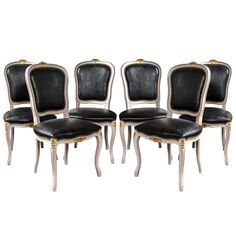 Set of Six Paint-Decorated Leather Dining / Side Chairs | From a unique collection of antique and modern dining room chairs at http://www.1stdibs.com/furniture/seating/dining-room-chairs/