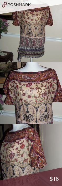 Forever 21 floral paisley top S/P Very nice top by Forever 21!! Floral and paisley earth tone colors. Excellent condition! Upper is made of 70% cotton,  30% silk. Bottom band that has side tie is 95% polyester,  5% spandex. Hand wash-cold. Cool iron if needed. Forever 21 Tops Blouses