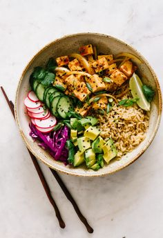 Tofu Poke Bowl... Healthy, vegan tofu poke bowls are great for lunch, dinner or make ahead meals (great for meal prep). Recipe is gluten free and takes about 20 minutes. #veganrecipes #healthyrecipes #cleaneating #vegan #pokebowl #easyrecipes #glutenfree