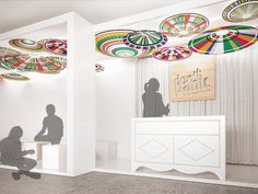 WOMEX 2014 / The ceiling composition was created from circular shades which by colour and form reminded of a polish folk costumes. The counter is a modern interpretation of polish sideboard.