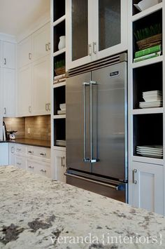 Altadore Fridge Surround / Veranda Estate Homes & Interiors. - love the pantry with pocket door.