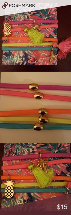 Lilly Pultizer GWP Hair Ties/ Bracelets 5 brightly colored Lilly Pultizer Hair Ties. 3 with fun gold charms. 2 with tassels. NWT. Store suggested that they could also be used as bracelets. Lilly Pulitzer Accessories Hair Accessories