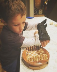 First time playing chess in about 16 years  With my boy this time.  Missing my grandfather for sure. Without his guidance I had to look up the damn rules!