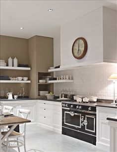 Taupe And White Details Make This Dark Hued La Cornue Range The Focal Part Of Kitchen