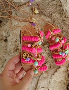Pom Pom Wonderland Gladiators Sandals    Handmade lace up gladiator leather sandals with charms for Kids and Baby girls. Wonderland sandals are adorned with fuchsia pom pom lace, colorful gemstone charms, shells, tassels, evil eye charm, crystals and acrylic beads.  Genuine High Quality Greek Leath