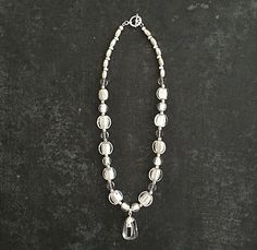 """Handmade statement beaded crystal pendant necklace Translucent Sparkle of Venetian glass beads with Vintage acorn shaped quartz beads. Hand crafted quartz and tourmaline pendant. 18""""long"""