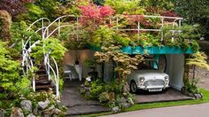 A garage might sound like an unseemly environment for lush vegetation, but award-winning landscape artist Kazuyuki Ishihara has built a jaw-dropping garden with a parked car as its centerpiece. At this year's Chelsea Flower Show in London, Ishihara presented Senri-Sentei, a two-tiered structure with a plentiful plot of plant life on its roof, a room with a chair and table, and a comfortable resting spot for an antique vehicle, creating a surprising harmony between garage and greenery…