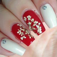 Dried flower nails with red and cream polish for Valentine's Day by @Laura Merino