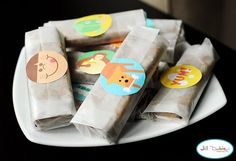 waxed paper-wrapped homemade granola bars + stickers from Martha Stewart