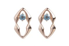 Rose gold plated plated silver studs featuring a stunning sky blue topaz. £336