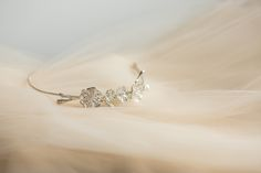 This gorgeous bridal tiara is made in sterling silver by expert artisans. Its beautiful four cherry flowers design symbolising femininity and romance, this tiara is the perfect final touch for the head of the bride.
