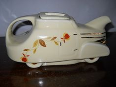 hall autumn leaf automobile tea pot  A rare piece I'm sure, I've never seen this tea pot in my life, and I've been around a long time. Love Autumn Leaf pattern distributed by Jewel Tea Co.  Mother had a whole set, I've got a few pieces.